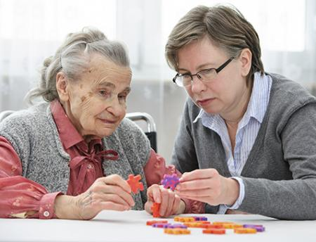 Photo of older woman and caregiver