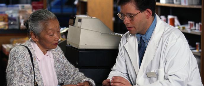 Photo of pharmacist advising customer
