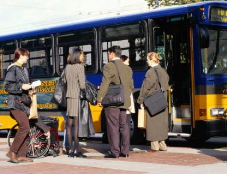 photo of people getting on a bus